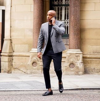Black Chinos Outfits: Go for elegant style in a grey double breasted blazer and black chinos. If you want to break out of the mold a little, introduce black leather tassel loafers to this look.
