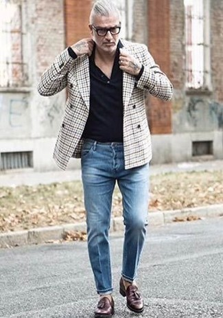 How to wear: grey plaid double breasted blazer, black polo, blue jeans, dark brown leather tassel loafers