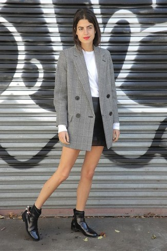 Try teaming a grey plaid double breasted blazer with a black leather mini skirt for a casual level of dress. Dress down your look with black leather chelsea boots.