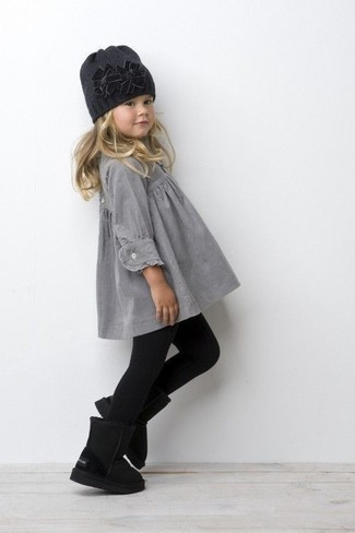 Girls' Looks & Outfits: What To Wear In 2020: Teach your little girl to take pride in her appearance by suggesting that she reach for grey dress. The footwear choice here is pretty easy: finish off this look with black uggs.