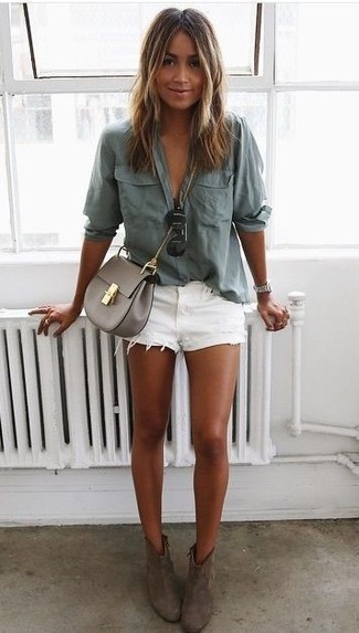 A grey button-up shirt and white denim shorts will give off this very sexy and chic vibe. Charcoal suede booties will become an ideal companion to your style. Perfect for summer, this look will gain quite a few likes on the 'gram too.