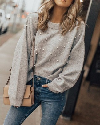 How to Wear Blue Skinny Jeans: When the situation permits off-duty styling, you can go for a grey embellished crew-neck sweater and blue skinny jeans.