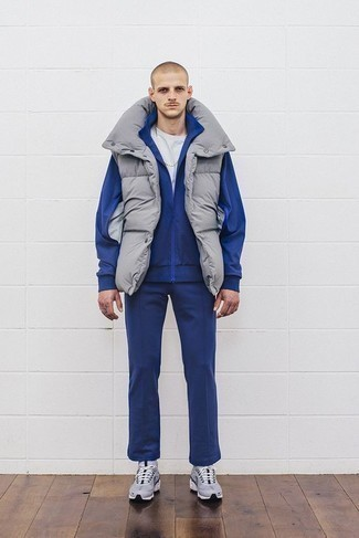 How to Wear a Track Suit For Men: The combination of a track suit and a grey gilet makes for a solid casual ensemble. Take a more laid-back approach with footwear and complete your look with grey athletic shoes.