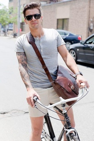 Men's Grey Henley Shirt, Beige Shorts, Brown Leather Messenger Bag, Black Sunglasses