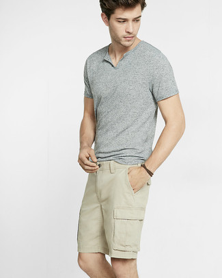 Go for a grey henley shirt and beige shorts to show off your styling savvy. As you can see, this is a killer pick for warm weather.