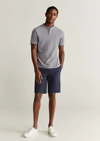 Grey Henley Shirt Outfits For Men: For a laid-back and cool ensemble, opt for a grey henley shirt and navy shorts — these two items play perfectly well together. A pair of white canvas low top sneakers is the glue that ties this outfit together.