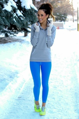 How to wear: grey hoodie, aquamarine leggings, green athletic shoes, white wool gloves