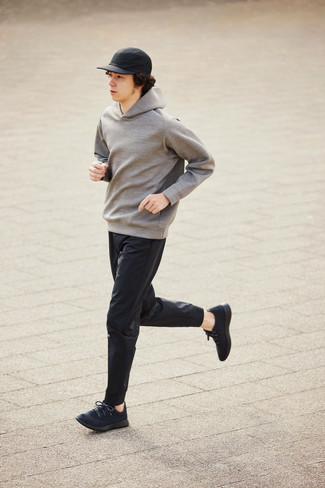 Grey Hoodie Outfits For Men: This combo of a grey hoodie and black chinos will hallmark your expertise in men's fashion even on weekend days. Introduce a touch of stylish casualness to by rocking a pair of black athletic shoes.