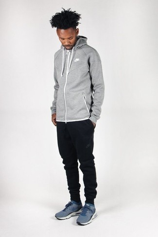 Grey Hoodie Outfits For Men: If you're searching for an edgy but also on-trend ensemble, make a grey hoodie and black sweatpants your outfit choice. A pair of navy athletic shoes finishes this outfit very well.