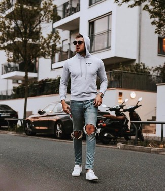 How to wear: grey hoodie, light blue ripped skinny jeans, white low top sneakers, black sunglasses