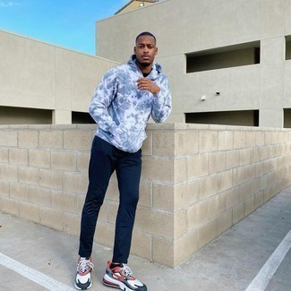 1200+ Relaxed Outfits For Men: If you put function above all else, try teaming a grey tie-dye hoodie with navy sweatpants. A pair of white and red and navy athletic shoes serves as the glue that will tie your getup together.