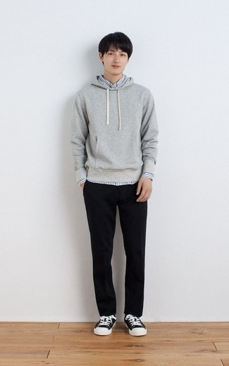 Black and White Canvas Low Top Sneakers Outfits For Men: This is hard proof that a grey hoodie and black chinos are amazing when worn together in a laid-back getup. If you don't know how to finish off, introduce black and white canvas low top sneakers to the equation.