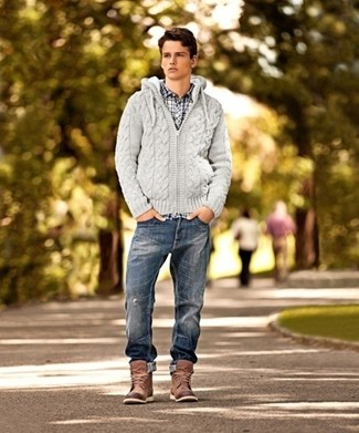 How to wear: grey knit hoodie, white and navy check long sleeve shirt, navy ripped jeans, brown leather casual boots