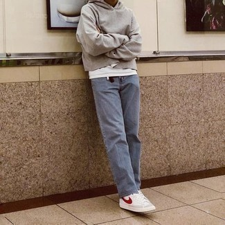How to Wear Light Blue Jeans For Men: For a casual and cool outfit, rock a grey hoodie with light blue jeans — these two pieces play nicely together. Feeling bold? Spice up your outfit by rounding off with a pair of white and red canvas high top sneakers.