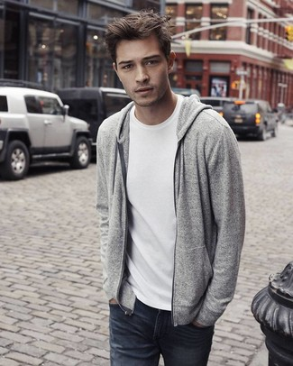 Which T-shirt To Wear With Charcoal Jeans For Men: This pairing of a t-shirt and charcoal jeans is proof that a simple casual outfit can still look really interesting.
