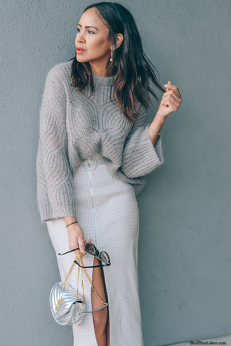How to wear: grey knit oversized sweater, beige slit midi skirt, silver leather crossbody bag