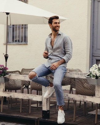 How to Wear Light Blue Ripped Jeans For Men: A grey linen long sleeve shirt and light blue ripped jeans are a great combo to add to your current rotation. If you wish to instantly play down this outfit with a pair of shoes, why not complete your ensemble with white athletic shoes?