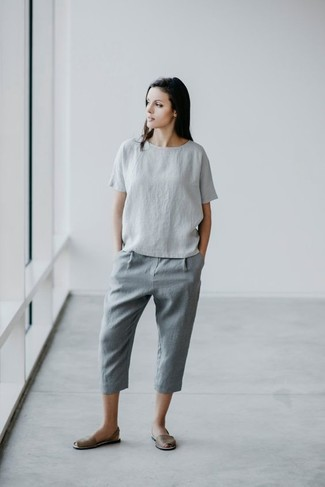 How to Wear Grey Leather Flat Sandals: This casual combo of a grey linen short sleeve blouse and grey linen chinos is very easy to throw together without a second thought, helping you look cute and prepared for anything without spending a ton of time searching through your closet. Introduce grey leather flat sandals to the equation to avoid looking overdressed.