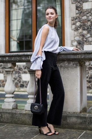 Perfect the smart casual look in a grey long sleeve blouse and St. John women's Collection Kasia Bootcut Milano Knit Pants. Black leather heeled sandals look amazing here. This here is hard proof that you totally can survive the summer heat, all while looking light and breezy.