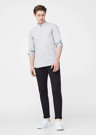 This combination of a grey long sleeve shirt and black chinos is impeccably stylish and yet it looks comfy and apt for anything. White leather low top sneakers will deliver more playfulness to your outfit. This one will play especially nice when hot weather hits.