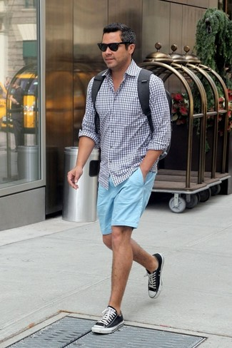 How to wear: grey gingham long sleeve shirt, light blue shorts, black and white canvas low top sneakers, charcoal backpack