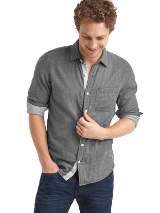 Dress in a grey long sleeve shirt and navy jeans for an easy to wear, everyday look. This one will play especially well come summer.