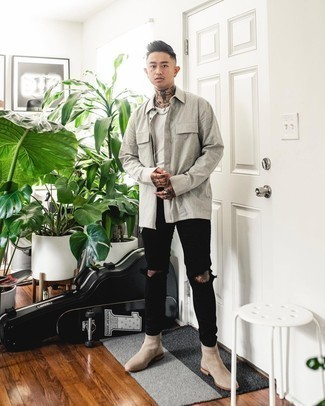 Beige Suede Chelsea Boots Outfits For Men: Uber stylish, this combination of a grey long sleeve shirt and black ripped jeans provides with variety. Introduce a pair of beige suede chelsea boots to this ensemble for a masculine aesthetic.