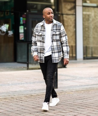 Men's Outfits 2020: Why not marry a grey plaid flannel long sleeve shirt with black skinny jeans? Both pieces are totally comfortable and will look amazing worn together. Let your styling savvy really shine by finishing this ensemble with white leather low top sneakers.