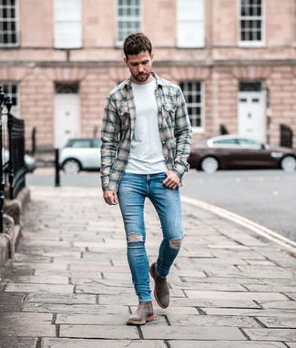 How to wear: grey plaid flannel long sleeve shirt, white crew-neck t-shirt, blue ripped skinny jeans, grey suede chelsea boots