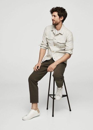 Shirt Outfits For Men: For a tested casual option, you can always rely on this pairing of a shirt and dark brown chinos. For something more on the sophisticated end to finish your ensemble, add a pair of white leather low top sneakers to the mix.