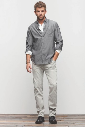 How to wear: grey long sleeve shirt, white long sleeve henley shirt, grey jeans, black leather desert boots