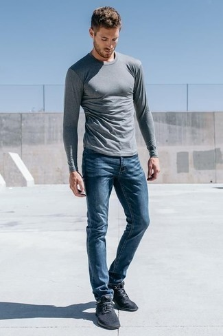 How to Wear Navy Athletic Shoes For Men: Consider wearing a grey long sleeve t-shirt and blue jeans for an effortless kind of class. To give your ensemble a more laid-back finish, add a pair of navy athletic shoes to the mix.