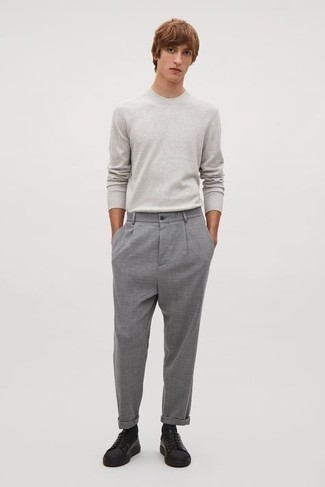 Men's Outfits 2020: You'll be amazed at how extremely easy it is for any man to pull together this casual look. Just a grey long sleeve t-shirt teamed with grey chinos. On the footwear front, this look pairs really well with black leather low top sneakers.