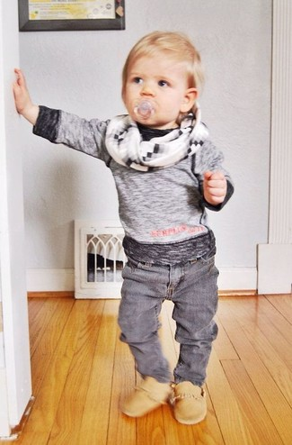 How to Wear a Grey Long Sleeve T-Shirt For Boys: Suggest that your son pair a grey long sleeve t-shirt with grey jeans for a laid-back yet fashion-forward outfit. This look is complemented really well with tan boots.