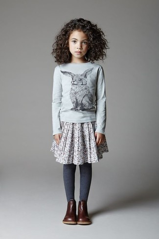 How to Wear a Grey Skirt For Girls: Suggest that your daughter team a grey long sleeve t-shirt with a grey skirt for a glam and trendy getup. This getup is complemented wonderfully with dark brown boots.