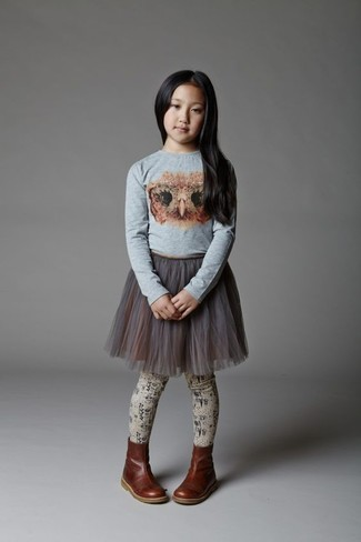 How to wear: grey print long sleeve t-shirt, grey tulle skirt, dark brown leather boots, beige tights