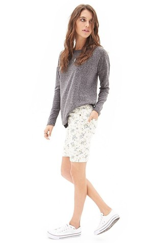 Try pairing a grey long sleeve t-shirt with white floral shorts to effortlessly deal with whatever this day throws at you. Want to go easy on the shoe front? Opt for a pair of white canvas low top sneakers for the day. Clearly, you're looking at a wonderful pick for a hot warm weather day.