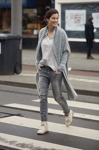Opt for a grey chunky open cardigan and grey jeans to create a chic, glamorous look. For the maximum chicness rock a pair of cream leather wedge sneakers.