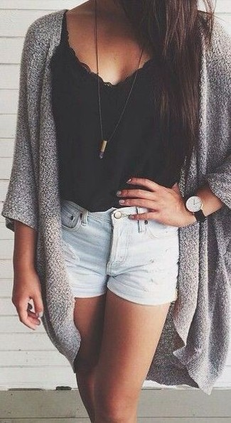 Let everyone know that you know a thing or two about style in a grey open cardigan and baby blue ripped denim shorts.