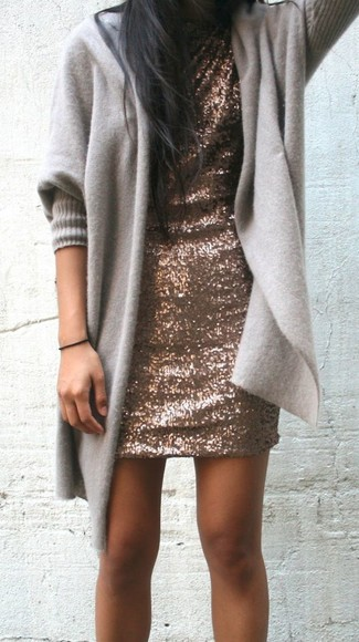 Reach for a grey open cardigan and a brown sequin shift dress for both chic and easy-to-wear look.