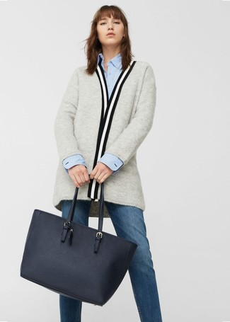 How to wear: grey open cardigan, light blue dress shirt, navy jeans, navy leather tote bag