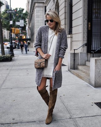 Go for a grey knit open cardigan and a white shift dress and you'll look like a total babe. Want to go easy on the shoe front? Opt for a pair of olive boots for the day. An ensemble like this is ideal for in-between weather.