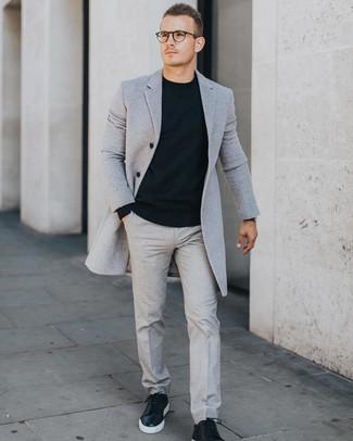 How to wear: grey overcoat, black crew-neck sweater, grey dress pants, black leather low top sneakers