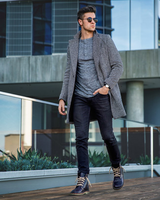 How to Wear Navy Leather Casual Boots For Men: A grey herringbone overcoat and black jeans are the kind of a fail-safe outfit that you need when you have no time to put together a look. Navy leather casual boots are the ideal companion for this ensemble.