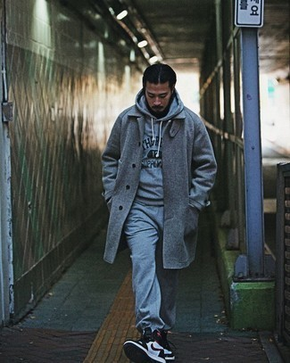 Grey Overcoat with Sweatpants Outfits: For a winning casual option, you can't go wrong with this combo of a grey overcoat and sweatpants. White and black leather high top sneakers will give a more relaxed feel to an otherwise dressy getup.