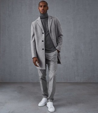 Men's Looks & Outfits: What To Wear In Chill Weather: Loving the way this combo of a grey overcoat and grey wool dress pants instantly makes men look refined and sharp. Introduce a pair of white leather low top sneakers to the equation to effortlesslly bump up the cool of this look.