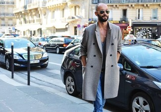 How to wear: grey overcoat, light blue jeans