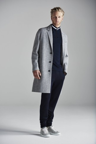 How to Wear a Navy Zip Neck Sweater For Men: Reach for a navy zip neck sweater and navy sweatpants for a daily look that's full of charisma and character. A pair of grey low top sneakers will be the perfect companion to your outfit.