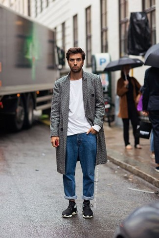 How to Wear Blue Jeans For Men: This classic and casual combo of a grey herringbone overcoat and blue jeans is super easy to pull together without a second thought, helping you look dapper and ready for anything without spending too much time going through your wardrobe. A pair of black athletic shoes easily dials up the appeal of your look.