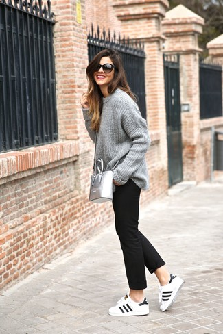 How to wear: grey knit oversized sweater, black chinos, white and black leather low top sneakers, silver leather crossbody bag
